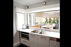 Brad and Lara's Challenge House Kitchen. Bi-fold window opening up onto courtyard, awesome! #theblock2012