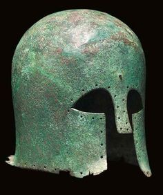 Corinthian helmet, second half of 7th century B.C.Of deep domed form, with narrow everted rear flange and rectangular nose-guard, pierced with multiple holes around the perimeter for lining attachment, a central rivet on forehead, pierced stud at rear and twin holes on crown for the attachment of crest, 23.5 cm high. Private collection, from Christie's auction