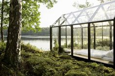 Now that is a modern garden shed.  Though I would use it for a green house.