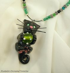 Polymer clay black kitty necklace by CrumpledFantazies