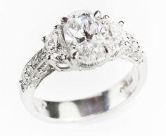 three-stone, emerald-cut platinum ring with 3-carat center stone. Newton's Jewelers, Fort Smith
