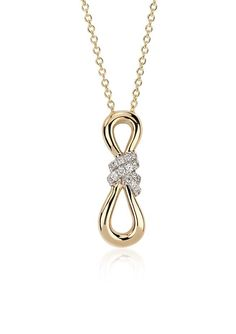 Brilliant and meaningful, this infinity diamond pendant features round diamonds pavé-set in 14k white and yellow gold.