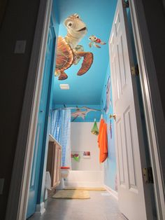 Our Nemo bathroom. The fathead decals were so big we had to paint the ceiling!