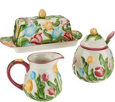 A charming addition to any table, this ceramic Temp-tations set includes a covered butter dish and sugar bowl, plus a creamer--all done in a lovely figural floral pattern. And, as always, each piece is dishwasher-safe for your convenience. From Temp-tations(R) Ovenware. QVC.com