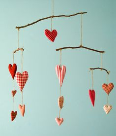 Mobile with 12 fabric hearts (5 largish and 7 smaller) and four sticks