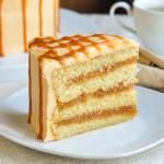 The Best Caramel Cake. A moist homemade vanilla cake, filled with layers of homemade caramel sauce, covered in a caramel buttercream frosting and drizzled with more caramel sauce.