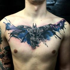 Batman tattoo. I love the the outline is the emblem.