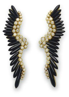 A PAIR OF ONYX AND DIAMOND EAR PENDANTS   Each designed as a feather, set with a scalloped line of graduated collet-set diamonds to the black onyx fringe, mounted in gold. [Looks 70s to me!]