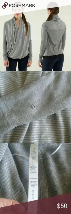 Lululemon Iconic Wrap Barely worn, heathered gray iconic wrap.  Wear it multiple ways.  Thumb holes to keep  hands warm! Back is darker gray than front.   Amazing and cozy!  One minor pull near bottom, barely noticeable. lululemon athletica Sweaters