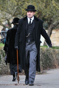 Mr. Bates with bowler hat and coat, watch fob and striped pants. Downton Abbey