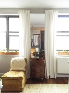 Want to really trick your eyes? Hang a mirror so that the edges hide just behind your window drapes. It gives the illusion of having a another space beyond the window wall, as you can see here on Lonny.
