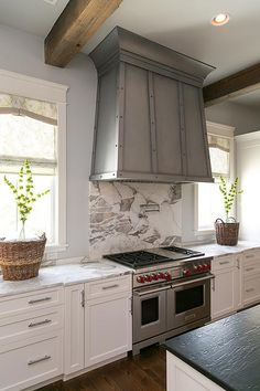 Gray and white marble slab backsplash