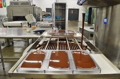 You can see the chocolate poured from the tempering machine where its heated and cooled and then poured into molds.