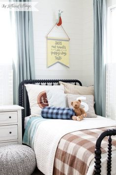 love this for a boys room. dark bed and tan checked blanket