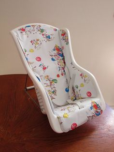 1970s adjustable baby infant chair seat. Side view. Made in Canada. I had one like this as a baby. I picked this one up at a local thrift store for $6. It was in the toy section but it is for babies not dolls. Though now my daughter uses it for her doll.