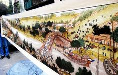 A Chinese man spent 5 years to reproduce the painting of Along the River During the Qingming Festival with cross stitch.   Along the River During the Qingming Festival by by the Song dynasty artist Zhang Zeduan is one of China's best known paintings, depicting street scene in capital Bianliang in today's Kaifeng, Henan Province.