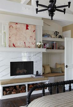 fireplace + built-in shelving + bench via traditional home