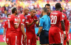 Switzerland protest a penalty being awarded by referee Bjorn Kuipers during the 2014 FIFA World Cup Brazil Group E match between Switzerland...
