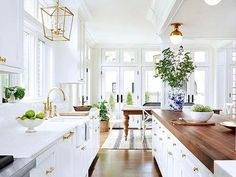 white kitchen, marble & gold, and warm butcher-block countertop island.