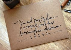 kraft paper envelopes w/ calligraphy