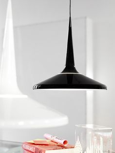 The Juicy pendant is an elegant modern pendant comprised of three components (wire, cone and shade) that fit smoothly together to create a striking whole.