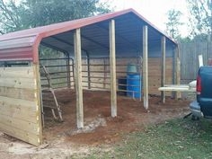 Another view of our horse shelter that we are building out of an existing carport. I will be using this as a foaling stall. We sunk in the front with the 2 in the middle spaced for a 4 foot door. Goat Shelter, Horse Shelter, Barn Stalls, Horse Stalls, Farm Plans, Shed Plans, Horse Shed, Horse Horse, Horses