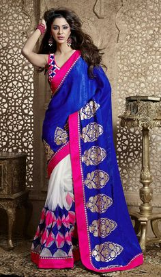 Blue off white georgette net wedding wear saree This half and half designer saree is beautified with dyed portion and floral foil work on the pallu portion along with resham geometrical work on the patli portion with glam to the pin stripes raw silk and zarri patch patti on all over the borders of the saree.