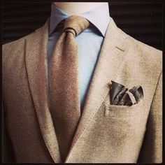 Tonal browns, tweed, collar spread.