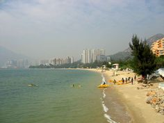 Golden Beach is located along Castle Peak Road on the outskirts of Tuen Mun in Hong Kong. It is the biggest among the several beaches located in Tuen Mun's Hong Kong Tourist Attractions, Hong Kong Beaches, Online Travel, This Is Love, Beaches In The World, Gold Coast, Places Ive Been, Travel Destinations, Castle