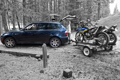 A BMW X3 Towing a BMW in the Dirt - Camping Photos