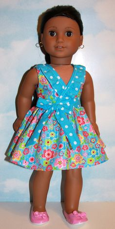 Turquoise and pink floral frill dress by SewLikeBetty on Etsy. Made using the Frill Seekers Dress pattern. Get it here http://www.pixiefaire.com/collections/forever-18-inches/products/frill-seekers-dress-18-doll-clothes. #pixiefaire #frillseekersdress