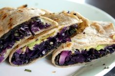Quesadillas with red cabbage, avocado, olive tapenade and goat cheese