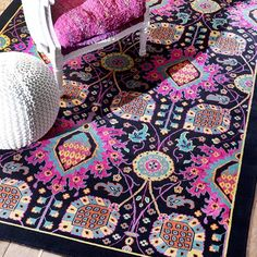 Showcasing an eye-catching abstract motif, this lovely rug adds a pop of pattern to your living room or den.