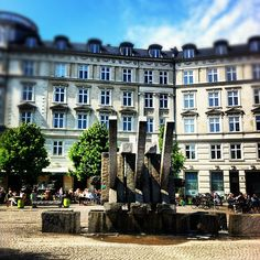 """Sankt Hans Torv (lit. """"St. John's Market"""") is a public square in the heart of the Nørrebro district of Copenhagen, Denmark. It is dominated by a large granite sculpture by Jørgen Haugen Sørensen and is known for its thriving café scen"""