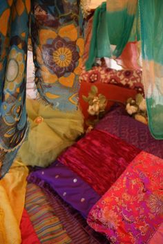 Beautiful, colorful textiles in bright bold colors of the Bo-ho rainbow!!! Want a room done in this style.