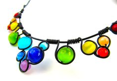 Wire Wrapped Necklace - Rainbow Cats Eye Beads Black Wire and Adjustable Matching Chain. $30.00, via Etsy.