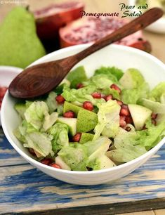 A warm dressing of pomegranate juice, lemon, mustard paste, honey and fresh pepper introduce a brilliant taste to the cut pear cubes. Toss in crisp iceberg lettuce too, it adds a definite crunch to the salad. Pomegranate Recipes, Pomegranate Salad, Pear Recipes, Pear Salad, Veg Salad Recipes, Sprout Recipes, Healthy Salads, Healthy Recipes, Kiwi