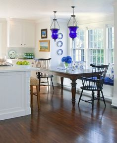 Nantucket Beach Home kitchen dining area with blue glass light fixtures featured on BNOTP - Kitchen Decor Magazine Kitchen On A Budget, Kitchen Dining, Kitchen Decor, Kitchen Ideas, Kitchen Cabinets, Kitchen Shelves, Kitchen Colors, Revere Pewter, Joanna Gaines