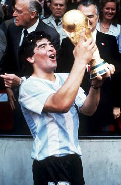 1986: Maradonna picking up the well deserved World Cup for Argentina in Mexico