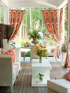 furnished porch with patterned curtains