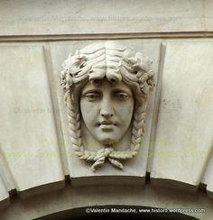 Allegorical feminine classical figure decoration on the lower window arch keystones