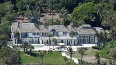 Tiger Woods' ex-wife bulldozes Twelve million dollar home. What a wasteful sinful bitch.