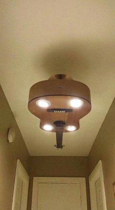 Guitar into light fixture!
