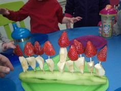 Edible menorah, healthy snack! I'm also going to do a flat one with carrots, celery, cream cheese, and little craisins for flames.