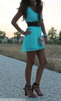 Love this turquoise dress, but id pair it with boots instead of heels.