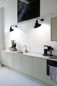 Maybe in white for task lamps in your kitchen? Kitchen with Black Sconces Green Kitchen Cabinets, Kitchen Tiles, Kitchen Decor, Kitchen Styling, Kitchen Fixtures, White Cabinets, Kitchen Lamps, Studio Kitchen, Upper Cabinets