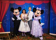 Alex and Paul invited special guests Mickey & Minnie to join in on their reception fun! Minnie's purple outfit perfectly complimented Alex's purple accents!