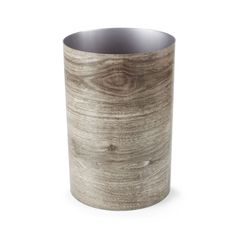 Even your trash will be crumpled up in style with this wood grain printed can wastebasket. Its perfect cylindrical shape will blend in with the rest of your bathroom décor, giving your space some rusti...  Find the Wood Grain Can Wastebasket, as seen in the Organic Minimalism Collection at http://dotandbo.com/collections/organic-minimalism?utm_source=pinterest&utm_medium=organic&db_sku=UMB0164