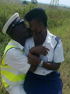 9JABREEZELAND: A photo of police officers kissing in the bush lig...