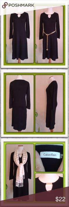 """The Basic Black CK Fall Dress Nobody does a basic black dress better than Calvin Klein. Perfect for fall to wear with boots or pumps.  Perfect Fall/Winter piece for your wardrobe.  100% soft acrylic.  Beautiful key-hole neckline adorned with a gold-tone bar. Long sleeve, mid-length hem. Size Medium. Measures: Chest (armpit to armpit) 17.5""""   Length 41""""   Sleeves 23"""". Pre-owned, worn a handful of times.  No defects. Calvin Klein Dresses"""